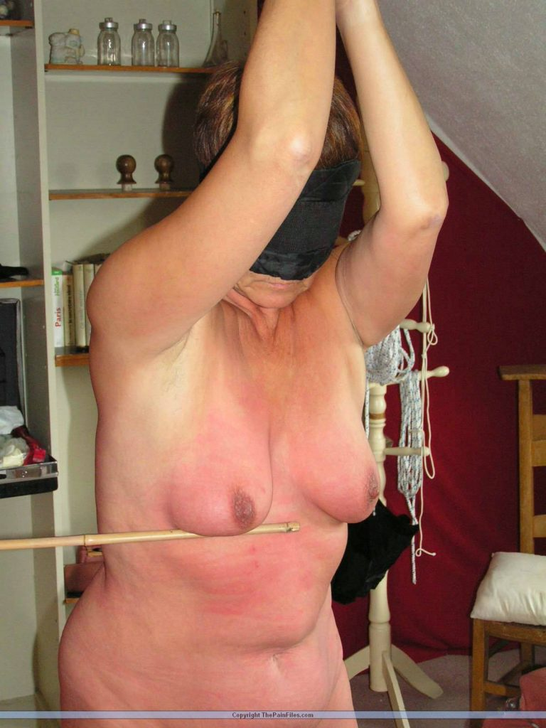 Bdsm redhead on rack